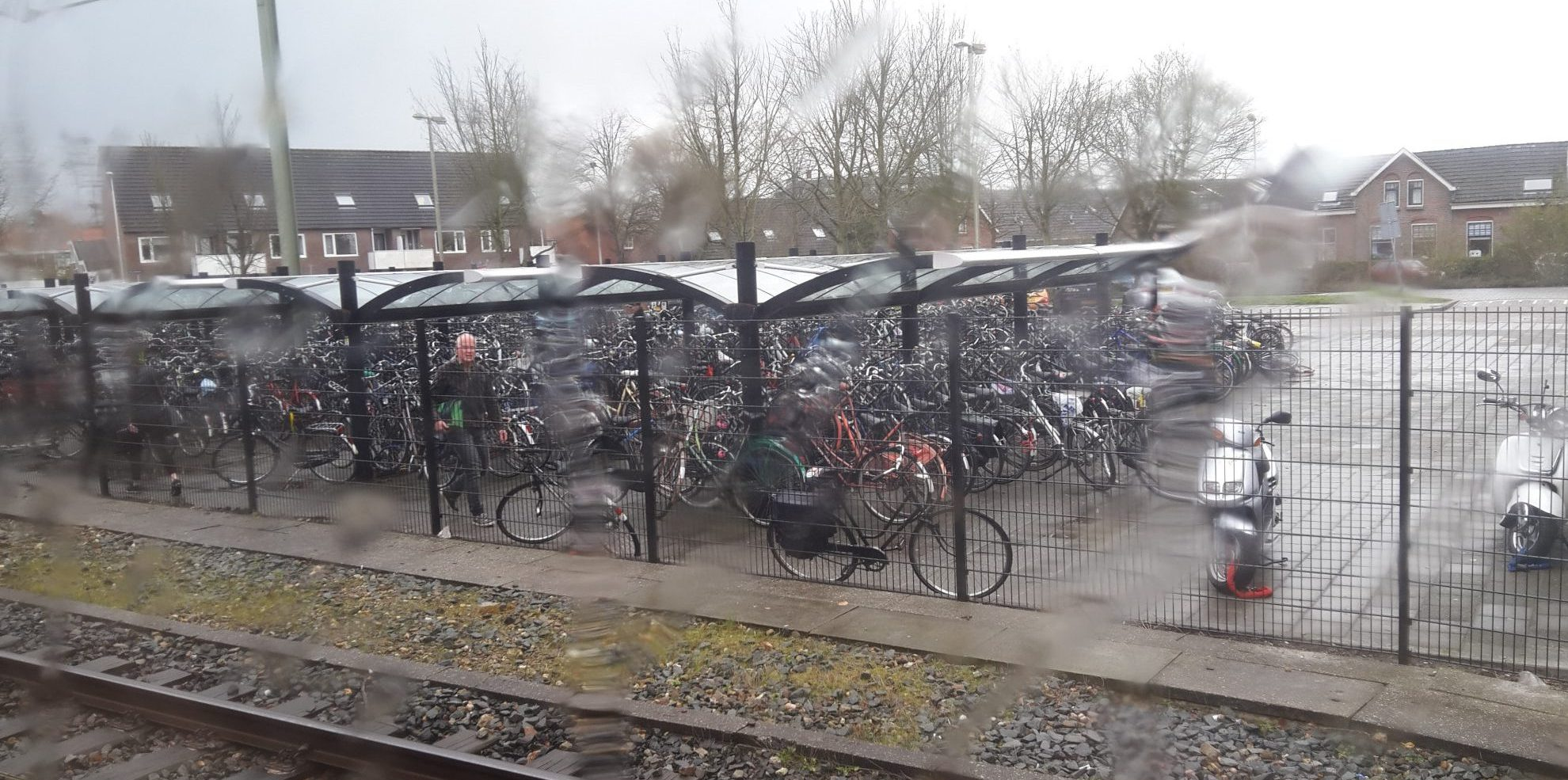 Bicycle parking at one of the stations along the way on my commute. Even on a rainy day, people bicycle.