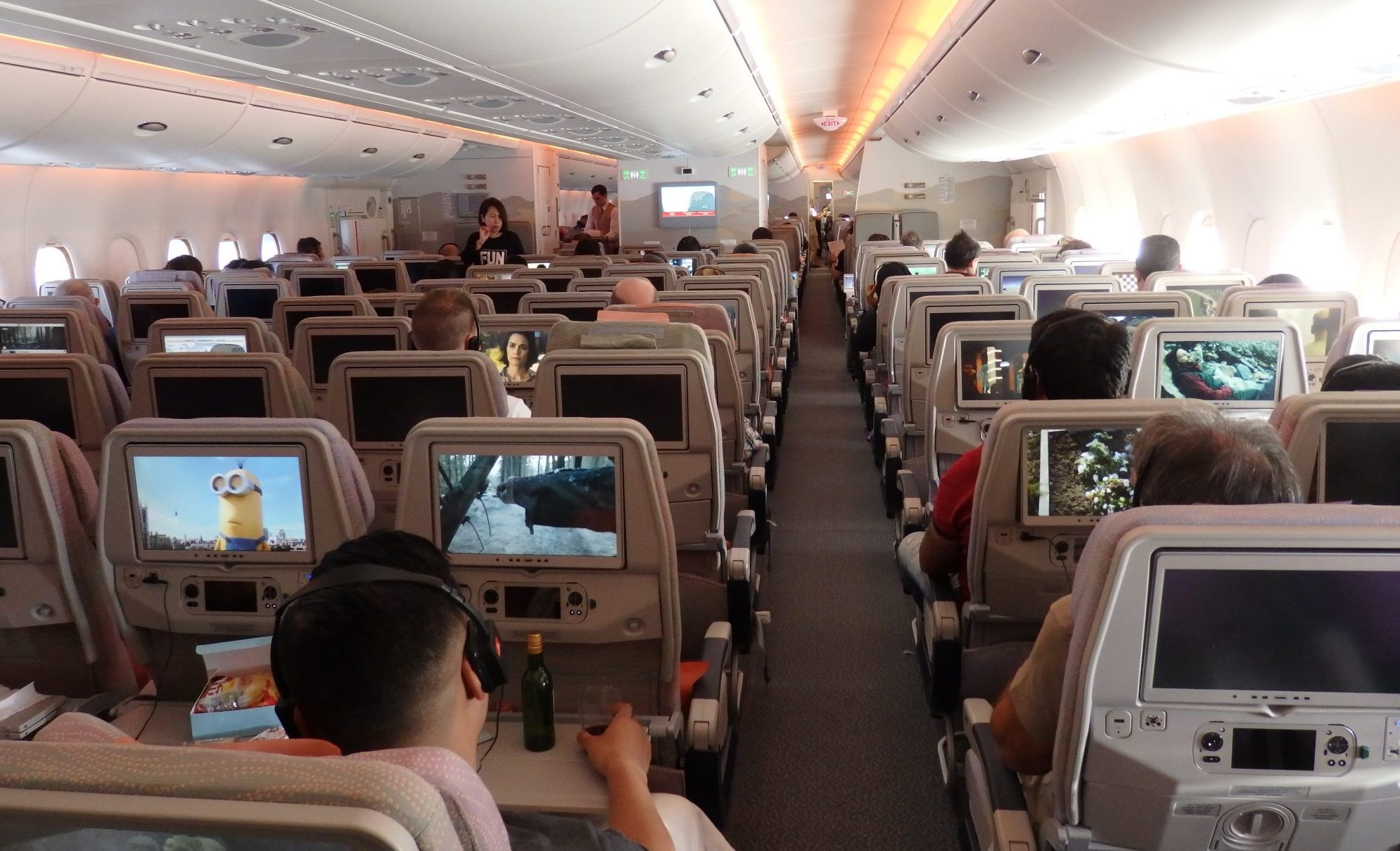 a view down the length of the Emirates A380. You can see the seatback screens here too. The photo was taking in the aisle and looks forward in the plane.
