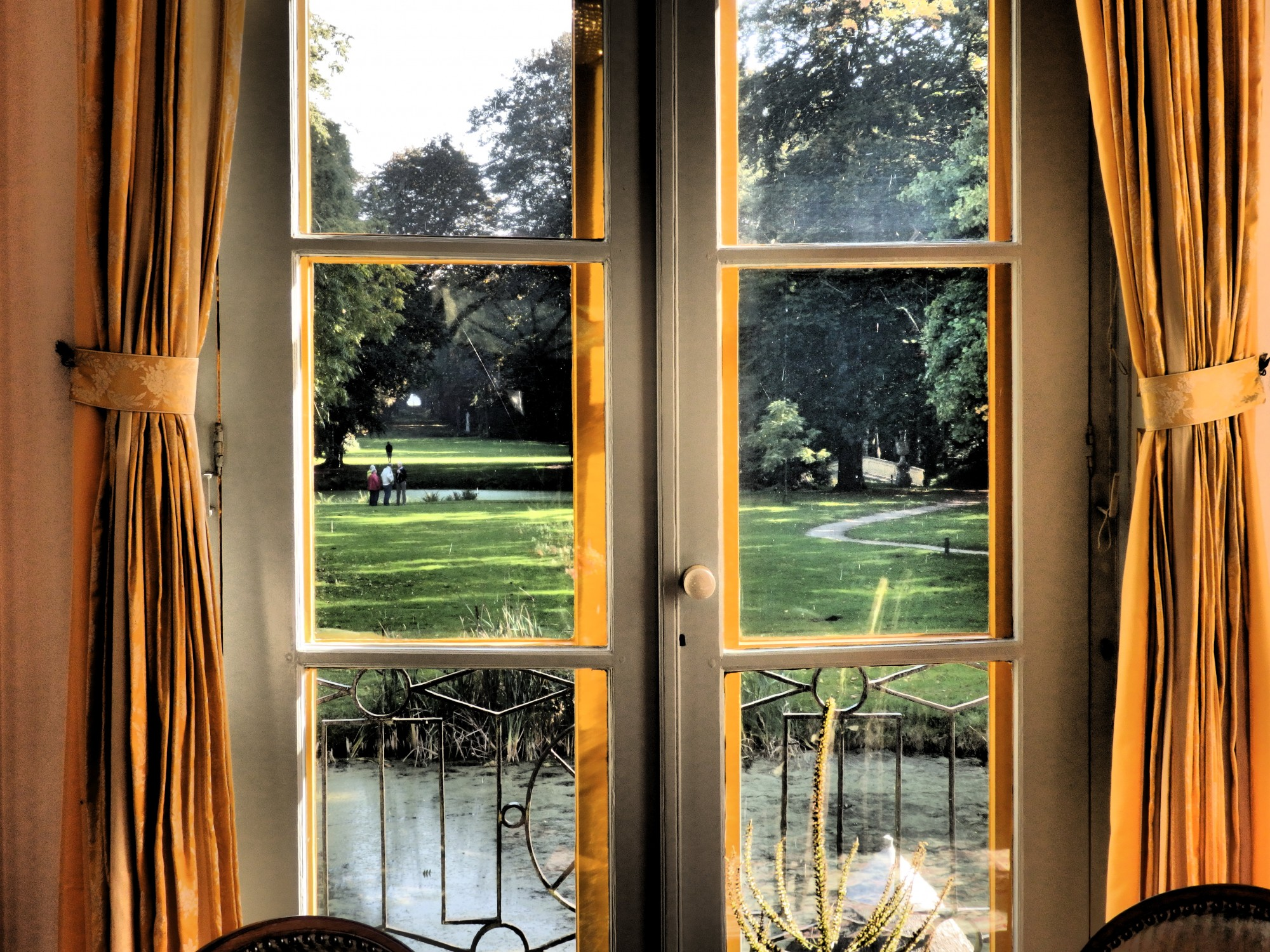 the view down the length of the garden as seen from inside the house, in Fraeylemaborg, Slochteren, the Netherlands
