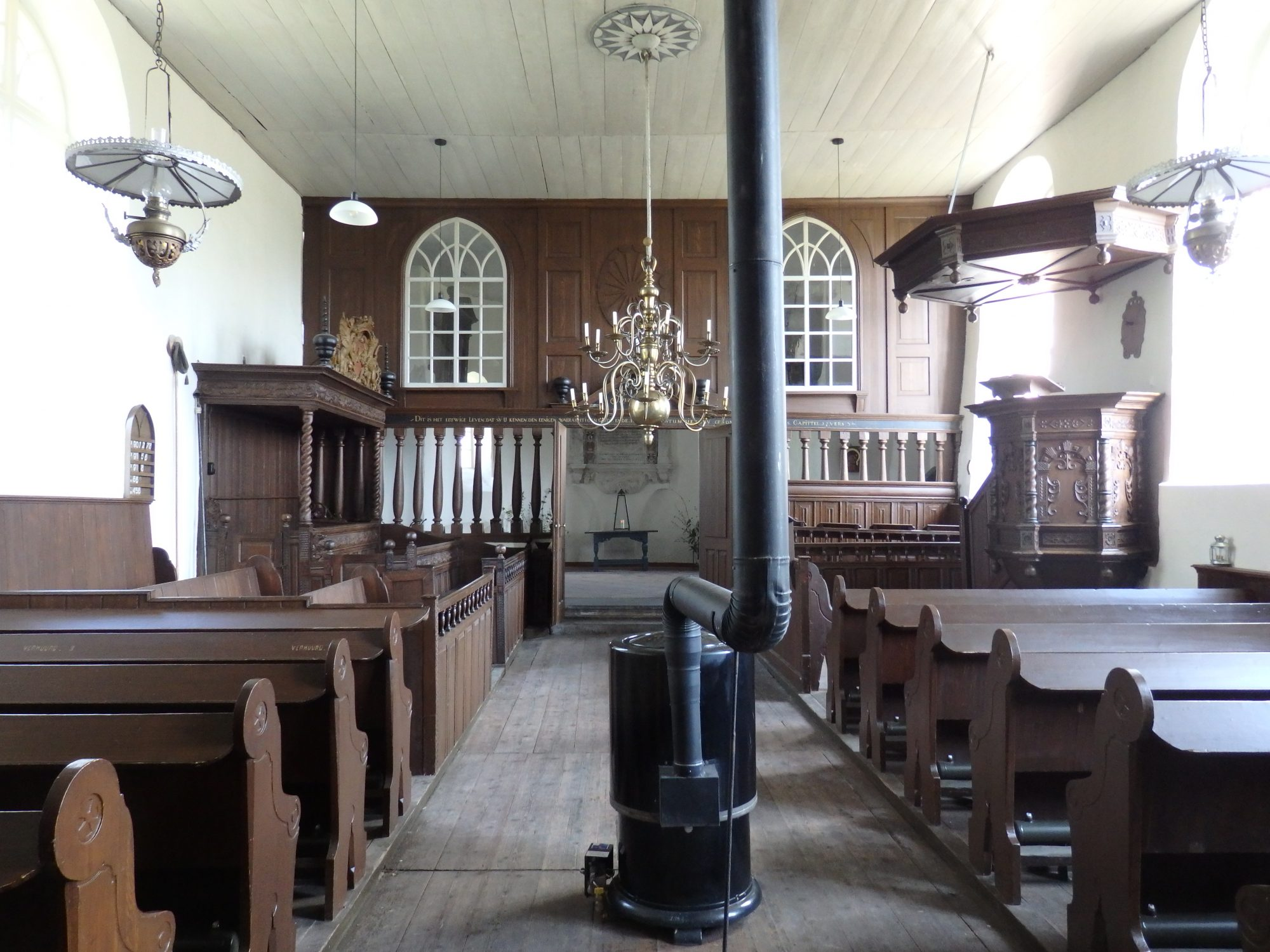 The interior of Oosterwijtwerd church, with a 19th century partition in front of the altar.
