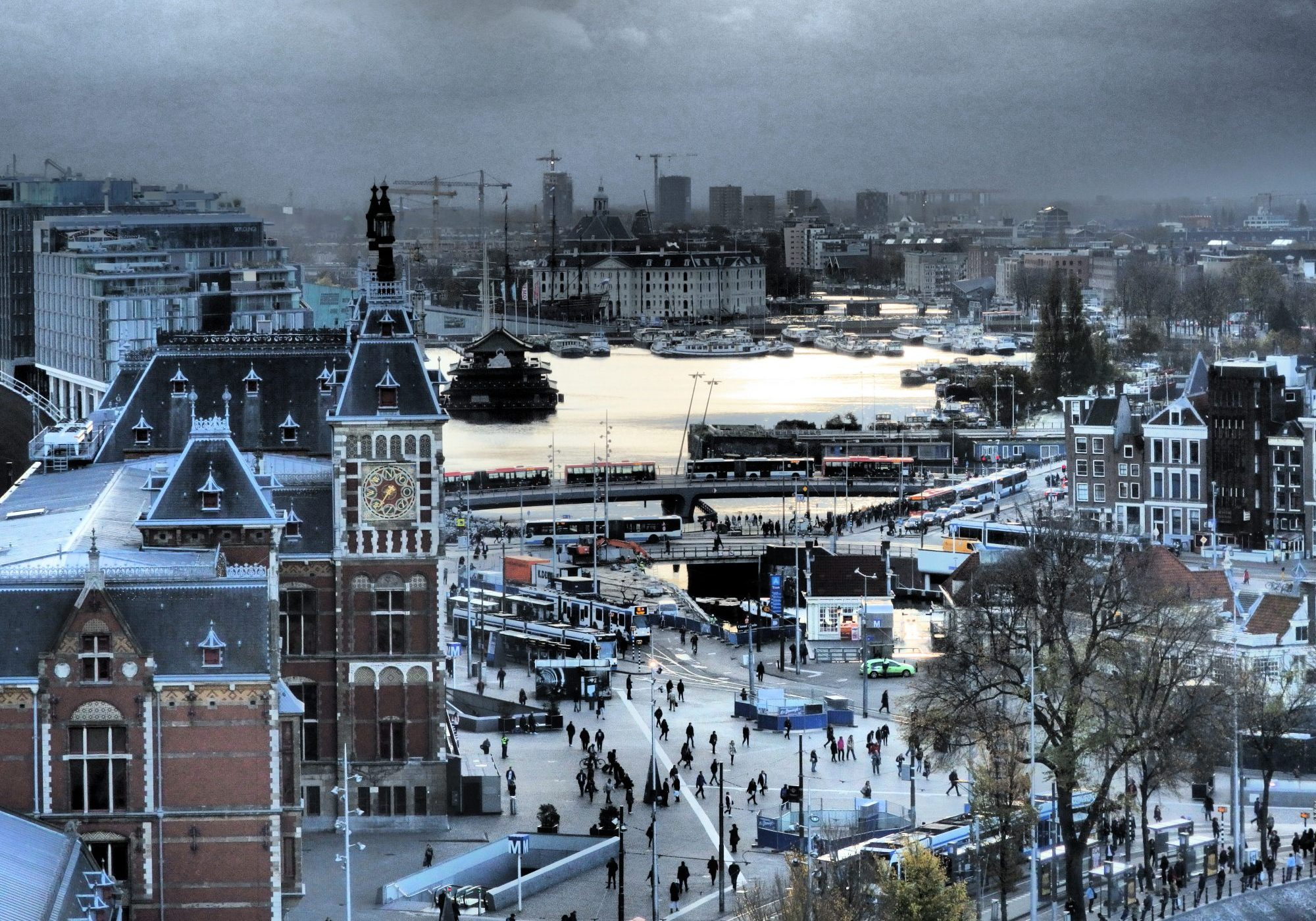 This picture shows Amsterdam Central on the left, and the plaza with tram stops in front of it.