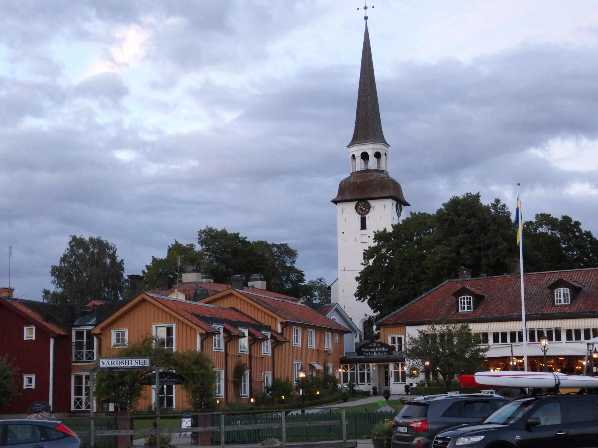 Gripsholms Värdhus, with the church towering above it, Mariefred, Sweden