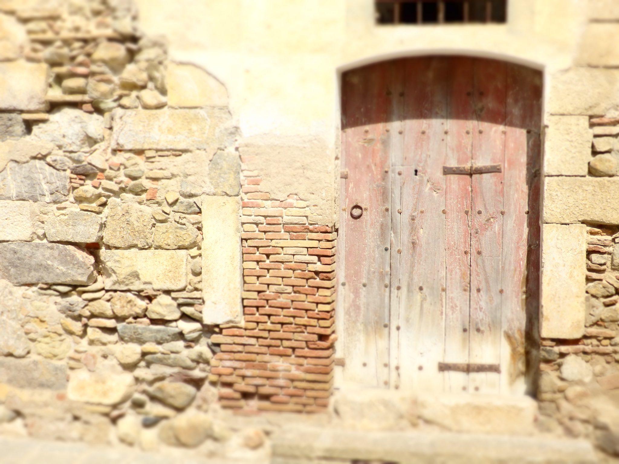 signs of age on a doorway in Peratallada,, Baix Emporda, Spain