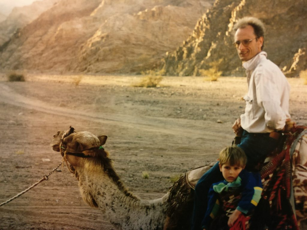 This snapshot shows our son suffering the indignity of being transported in a camel's sidesaddle because he wasn't big enough to ride the camel like the rest of us.