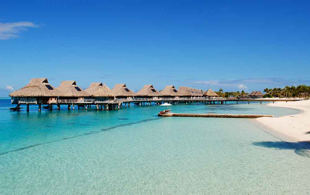 Bora Bora huts. Photo courtesy of Debbra Kunning Brouillette.