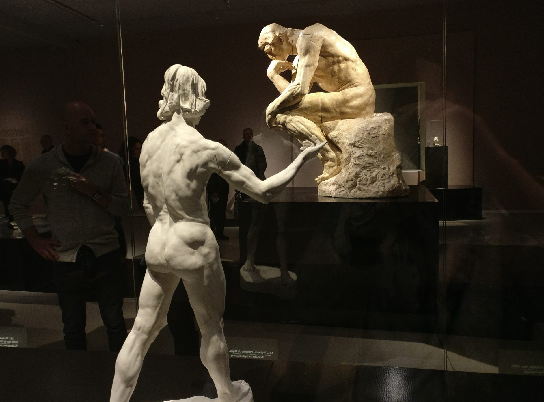 Two Rodin works: In the foreground, a small plaster cast of St. John the Baptist Preaching (1878). In the background, a large statue of The Thinker in patinated plaster from 2903.
