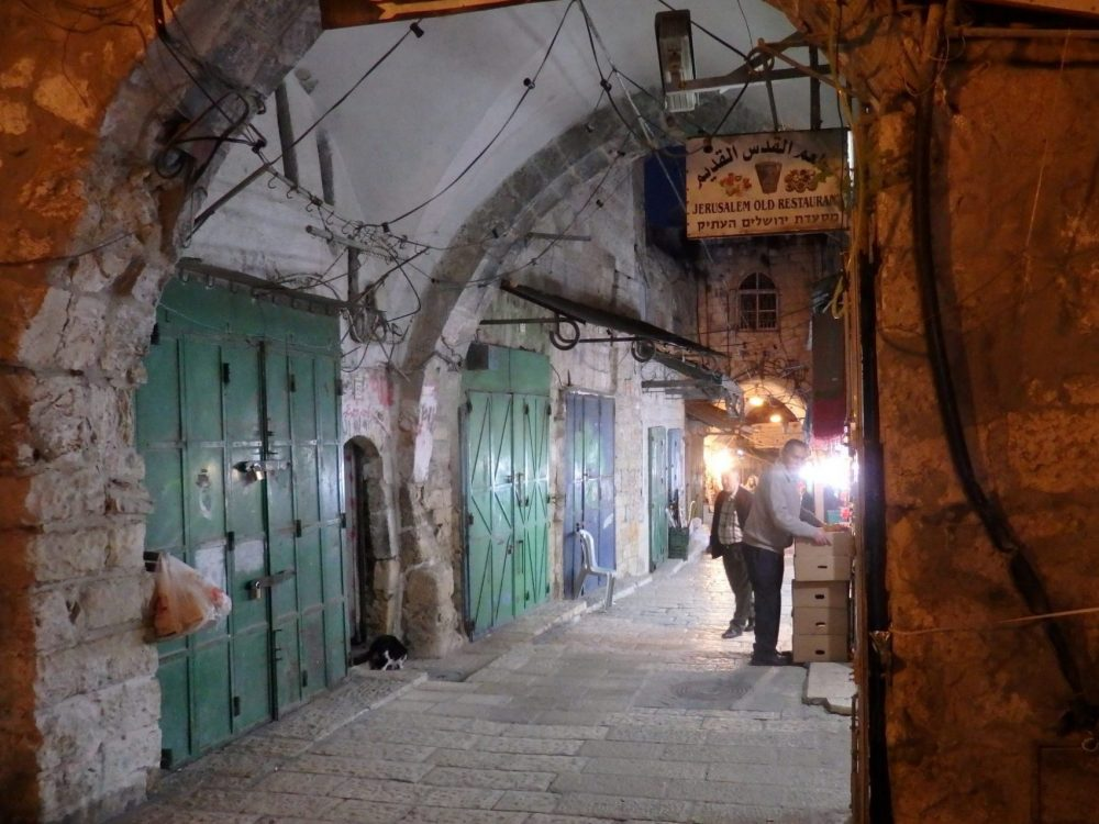 A street in the Old City of Jerusalem, in the evening when the shops are closing.