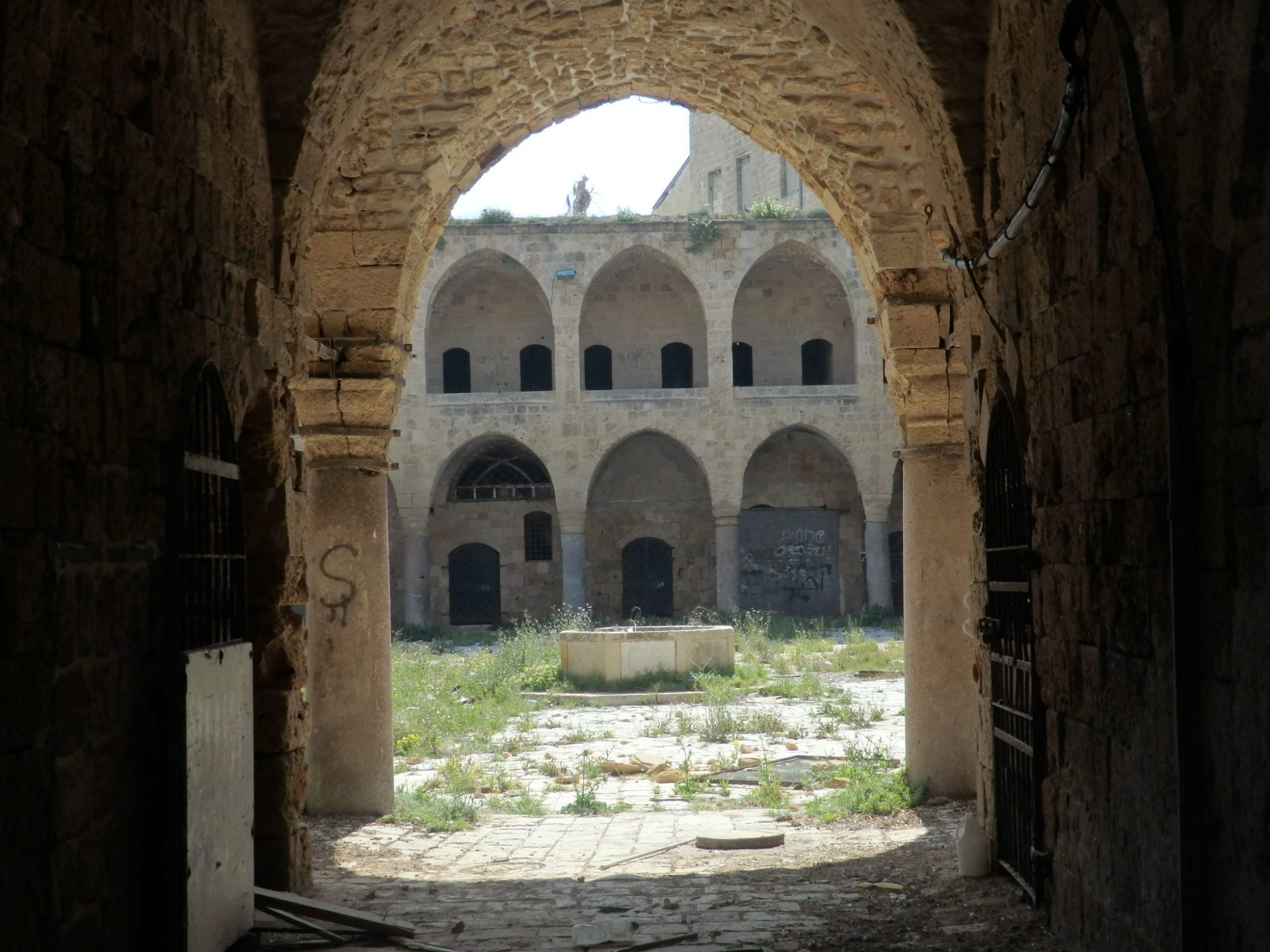 Khan al-Umdan, near the port in Akko old city, as seen through the closed-off entrance. Built in 1784, it included 40 columns made from stone brought from ancient Caesarea and Atlit. It seems to be abandoned now.