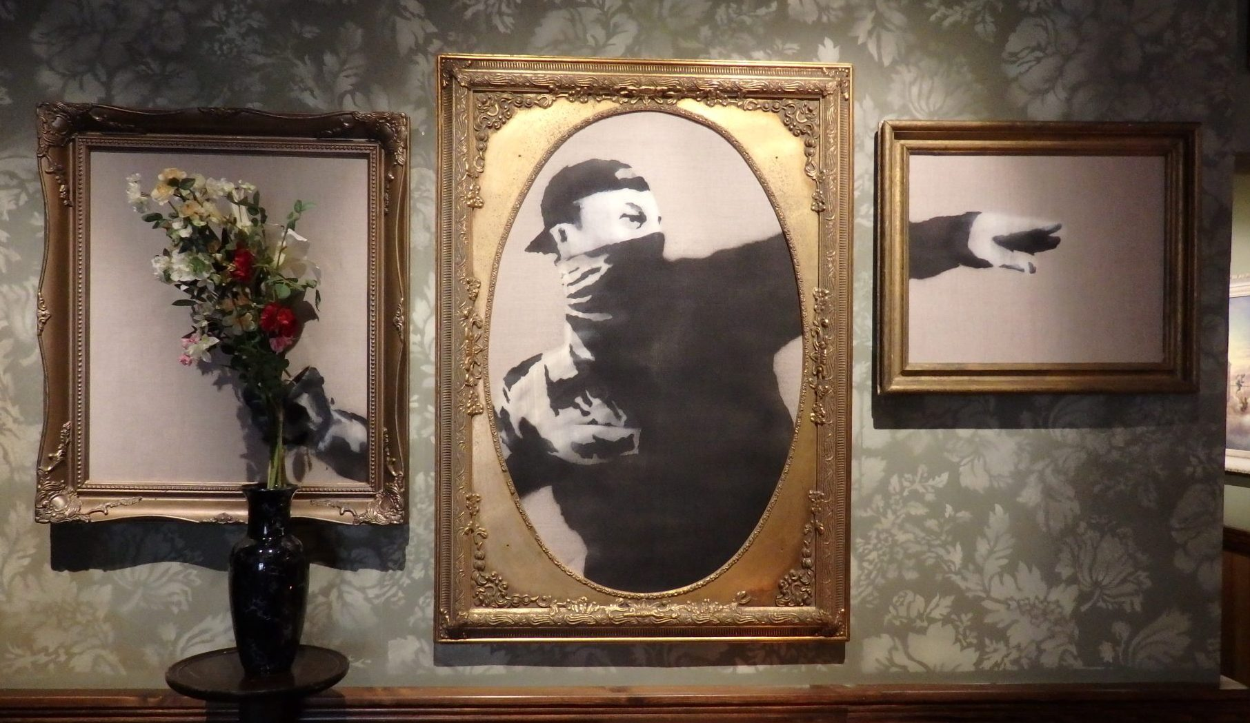 Visiting Bethlehem: artwork in the Walled Off Hotel, presumably by Banksy.