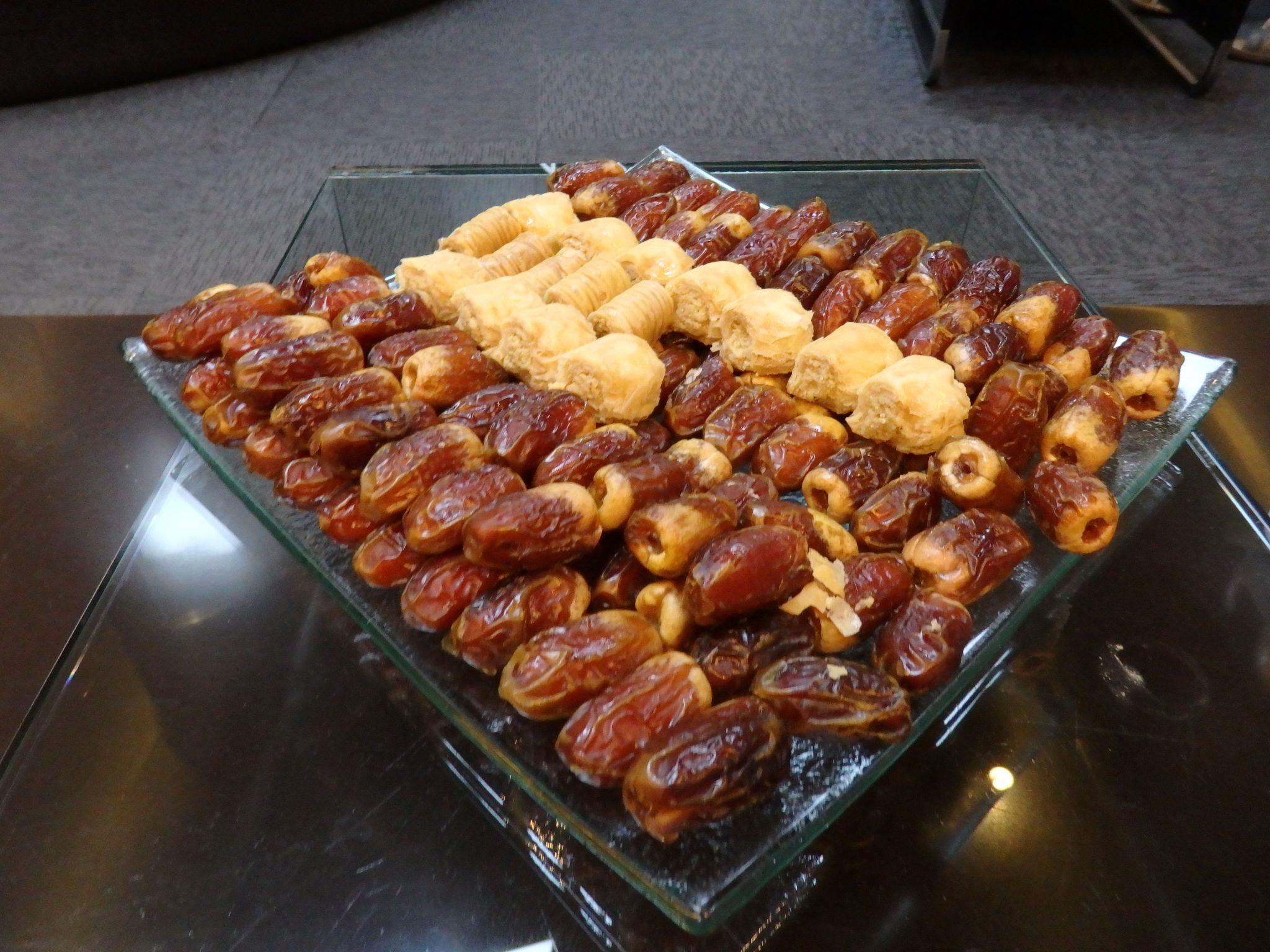 "A tray of dates and Arabic sweets in the ""lounge"" where we waited."