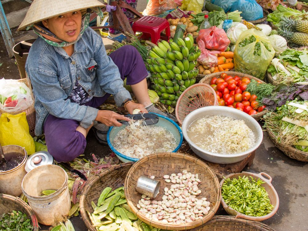25 tips for women traveling solo: a market vendor in Hoi An, Vietnam. Photo courtesy of Anita Breland of Anita's Feast.