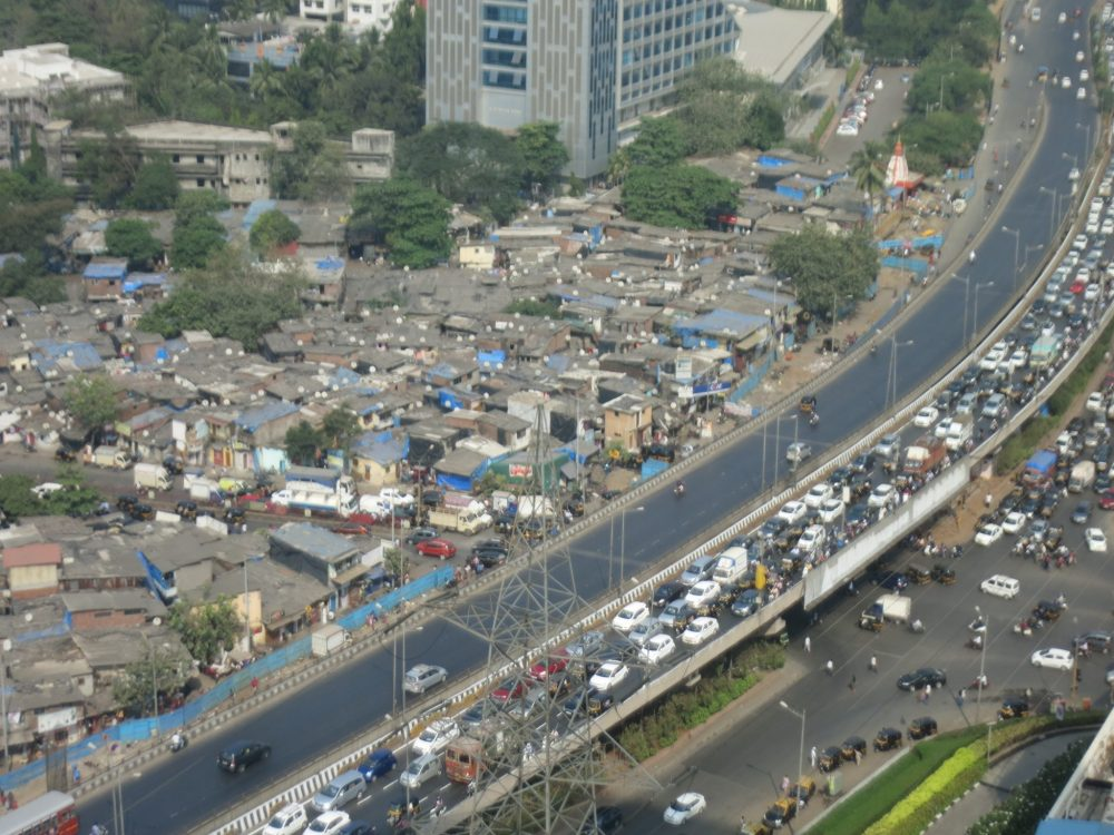 Part of the view from the 18th floor at breakfast. Here you can see some of the slum and some of the highway, with inbound morning traffic. Impressions from my first time in India