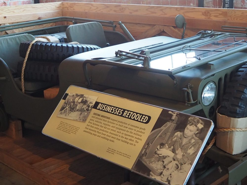 As this display explains, a jeep that is partly disassembled like this can be efficiently stacked for shipment. Rosie the Riveter Museum.