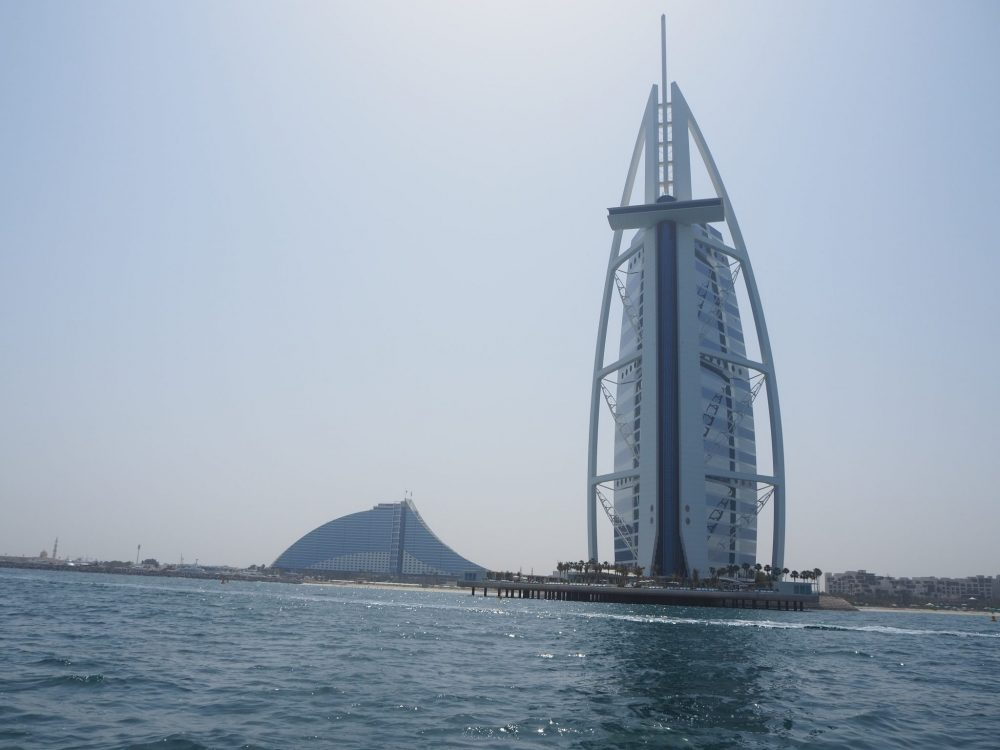 The Burj Al Arab as seen from the water. That interestingly-shaped building behind it is the Jumeirah Beach Hotel.