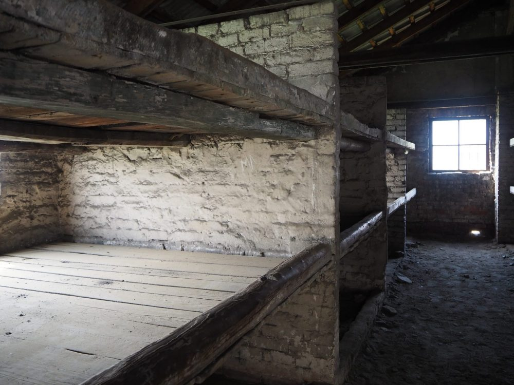 Barracks for the prisoners at Auschwitz-Birkenau, where they slept three high on shelves, several people per shelf.