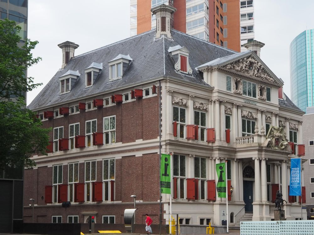 Schielandshuis is a square stately building in brick with a columned entrance. The whole front facade is embelllished with columns between the windows and ornate statuary above the windows, especially on the central pediment.