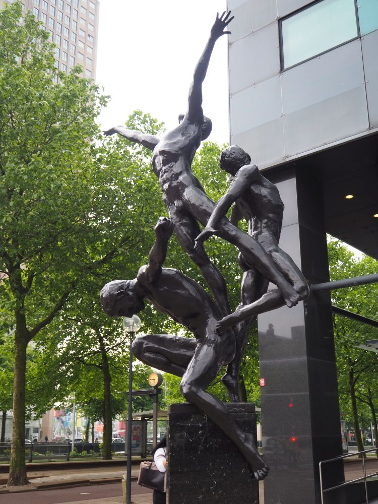 Triumph, by Kees Verkade, is a bronze statue and shows three naked figures in graceful poses, like gymnasts.