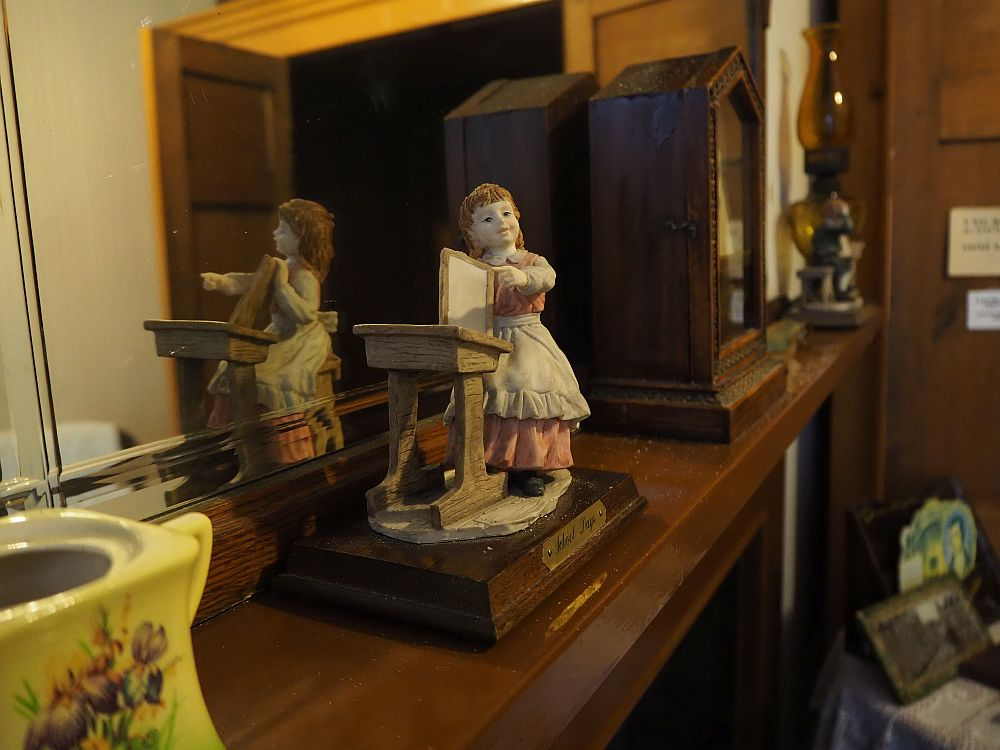 "Detail from one of the overcrowded rooms at the Wick Heritage Museum. My mother called items like these that sit on shelves and collect dust ""chotchkes""."