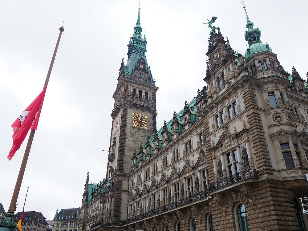 The Rathaus is an ornate building, with a tall tower, copper green roofs and lots of statuary.