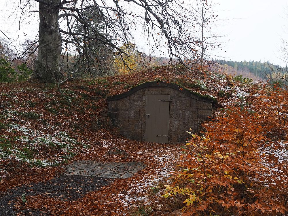All that is visible is one low wall, since the icehouse is built into a small hill.