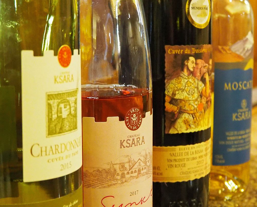a row of 4 bottles of Chateau Ksara wines
