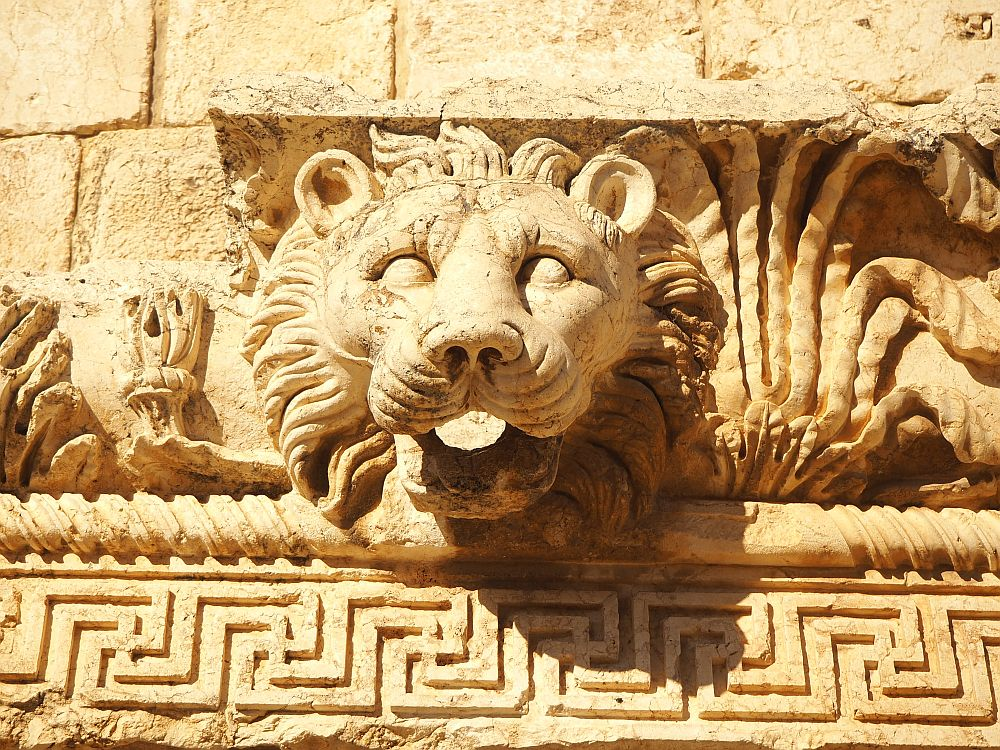 This lion's head extends out of a decoratively carved stone. I think it might have been a gargoyle to drain rainwater from the roof.
