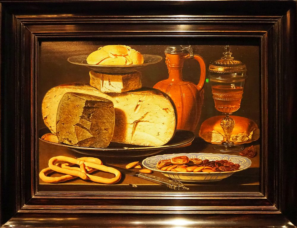 A remarkably detailed still life. In particular, the silver knife in front is clear enough to be a photograph.