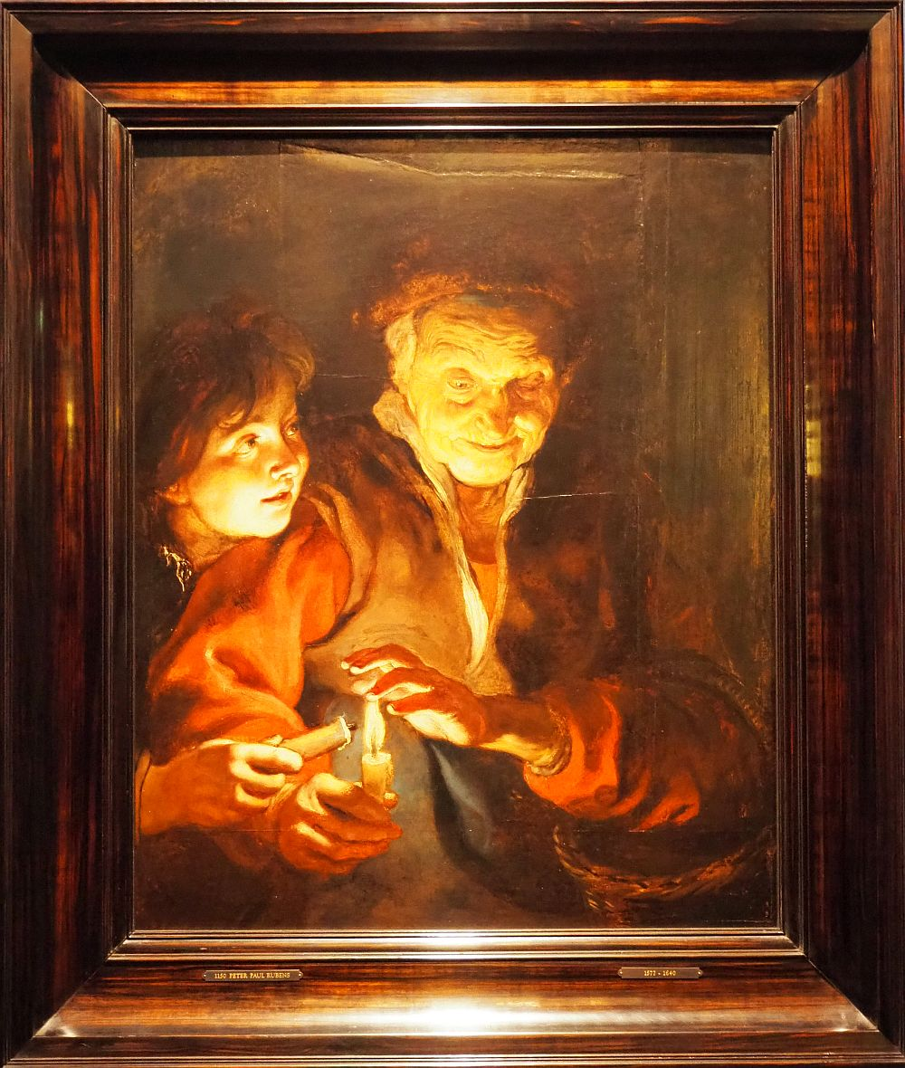 The light in this painting all comes from the candle the woman is holding, lighting up her face as well as the boy's beside her.