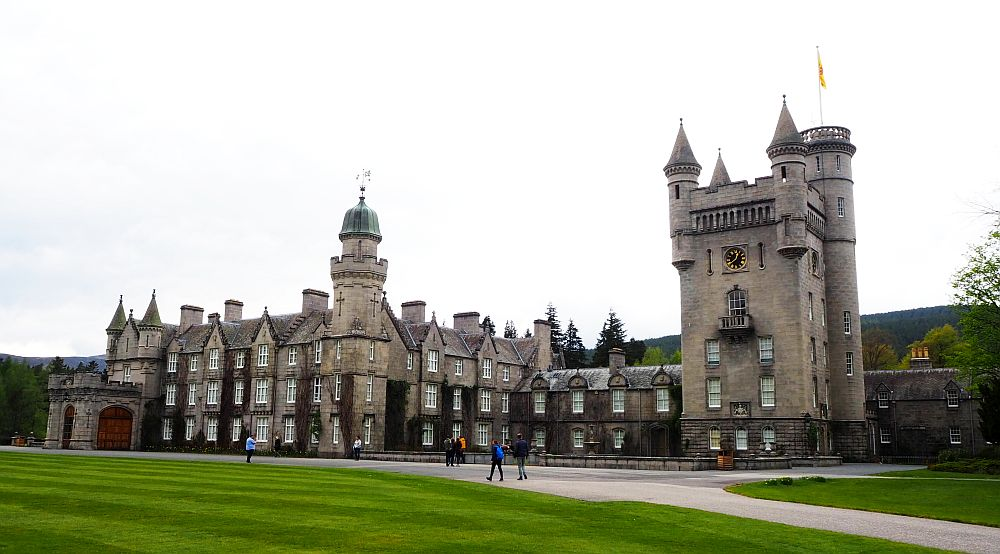 A sprawling castle with one big square, crenellated tower.