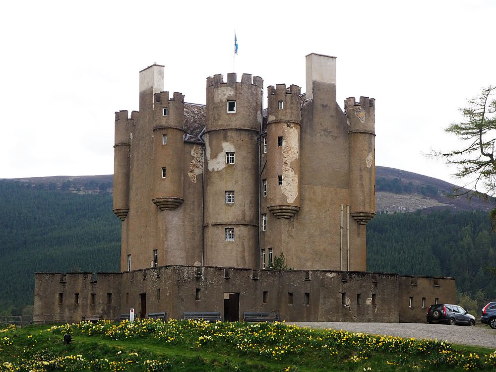 a compact, vertical castle with rounded towers and crenellations
