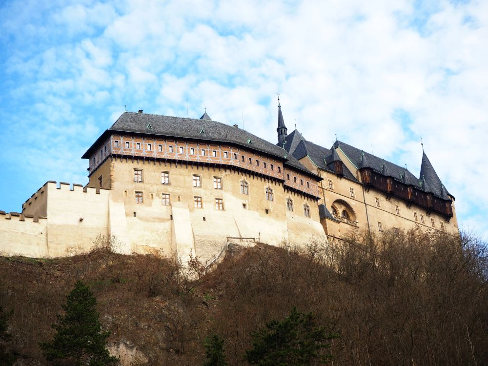 In this view, more of the walls are visible and less of the towers. Visiting Karlstejn Castle from Prague