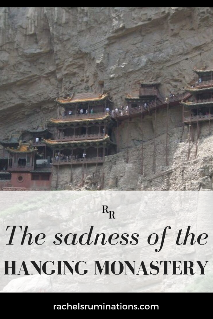 PInnable image: Text: The sadness of the hanging monastery Image: a view of the monastery, perched high up on a sheer cliff wall.