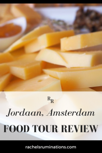 Pinnable image: Text: Jordaan, Amsterdam Food Tour Review Image: close-up of blocks of cheese