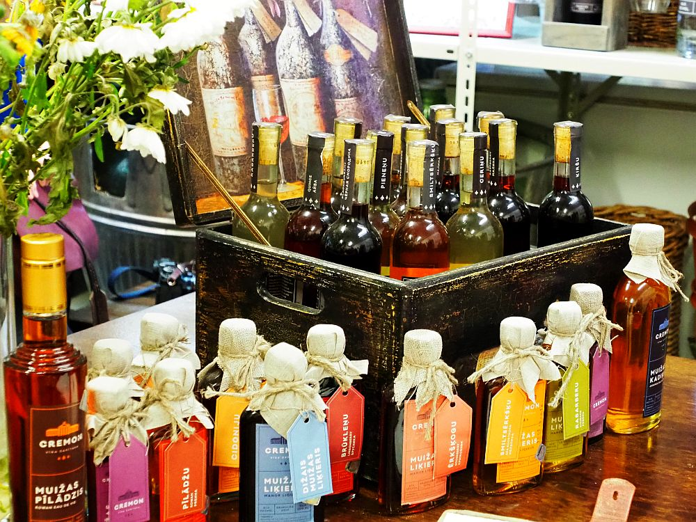 In a small chest, 14 bottles holding a range of colors of wine. In front of the chest are 13 more, smaller bottles that look more like liquor bottles than wine bottles. These dessert wines are a good example of the kind of artisanal production that is growing in Latvia these days.