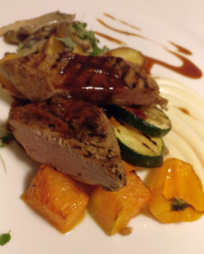 The pork has a brown gravy on it and sits on top of some pieces of carrot and slices of zucchini. This is not particularly traditional, but it's a good example of the Latvian food scene today.