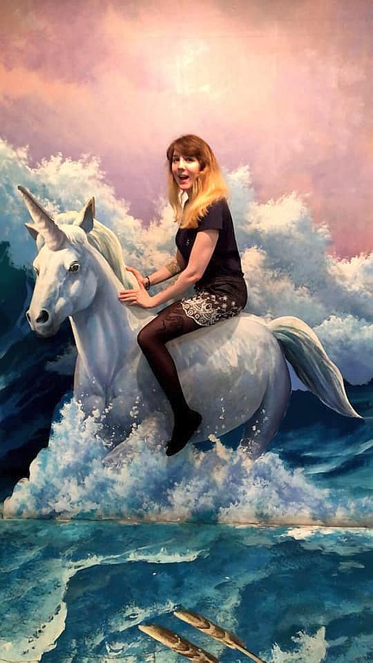 In the Trick Eye Museum in Hongik University Street, Jessica Esa appears to be sitting on a cartoon unicorn, dashing through water with a wave threatening them in the background.