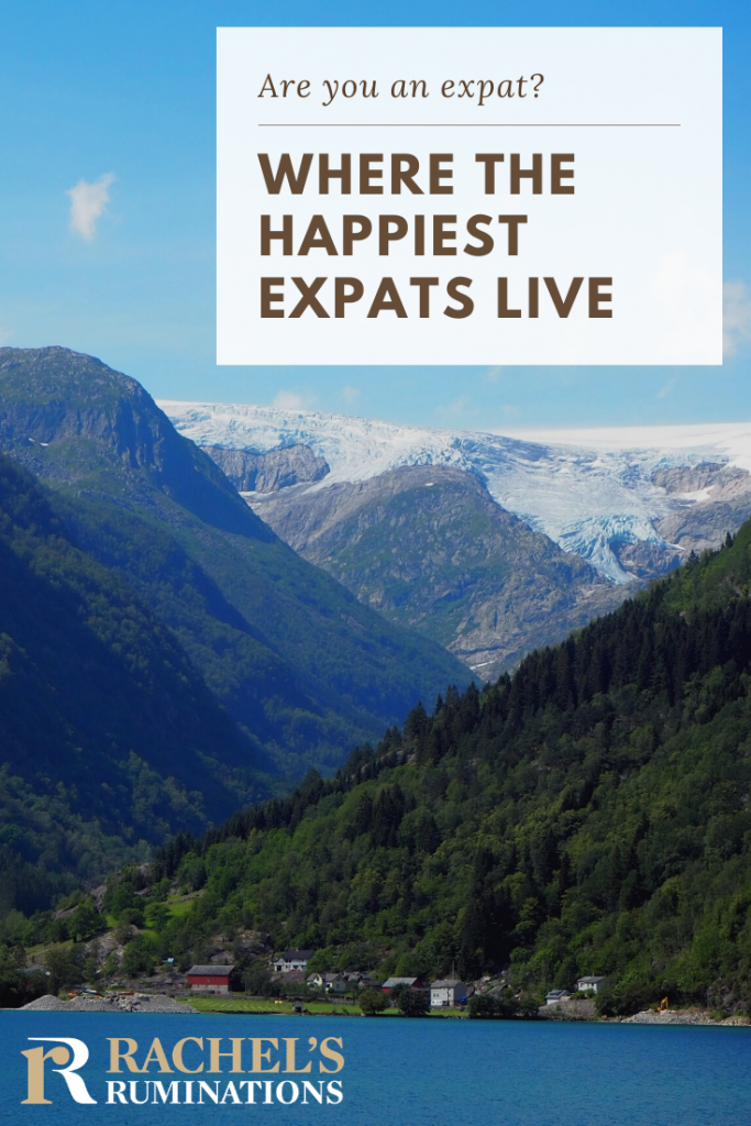 Pinnable image: Image: the same photo as above of the village with mountains looming around it. text: Are you an expat? Where the happiest expats live. (and a Rachel's Ruminations logo.