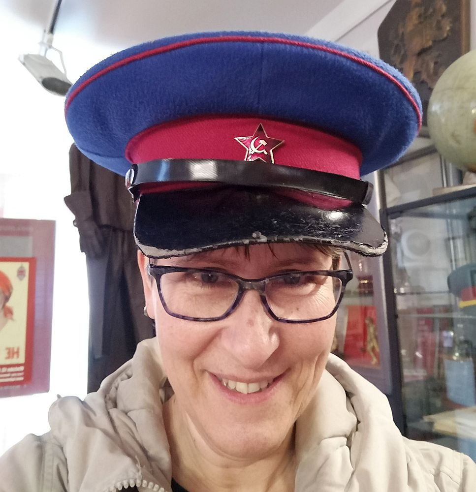 This is a head shot of me wearing an army cap that has the red star with a hammer and sickle above the brim. This guy was far too enthusiastic about communism in Prague!