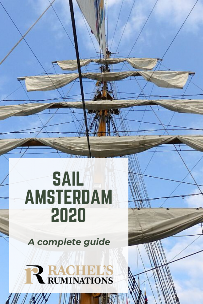 Pinnable image Photo: Looking up at a tall ship mast with five sails, furled on horizontal beams, one above the other. Text: SAIL Amsterdam 2020: A complete guide (and Rachel's Ruminations logo)