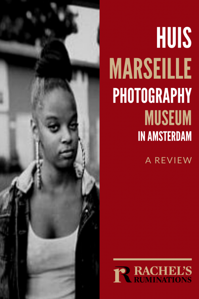 Pinnable image Text: Huis Marseille Photography Museum in Amsterdam: A review (and the Rachel's Ruminations logo) Image: a young African-American woman with her hair on top of her head in a bun, large dangling earrings, looking at the camera with half-open eyes.
