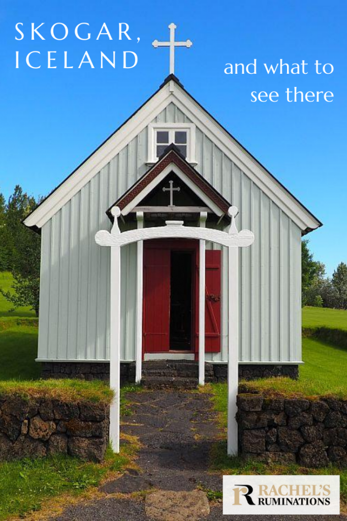 Pinnable image: Text: Skogar Iceland and what to see there Image: direct front view of a smalll church: white with a red door and a cross on the peak of the roof.