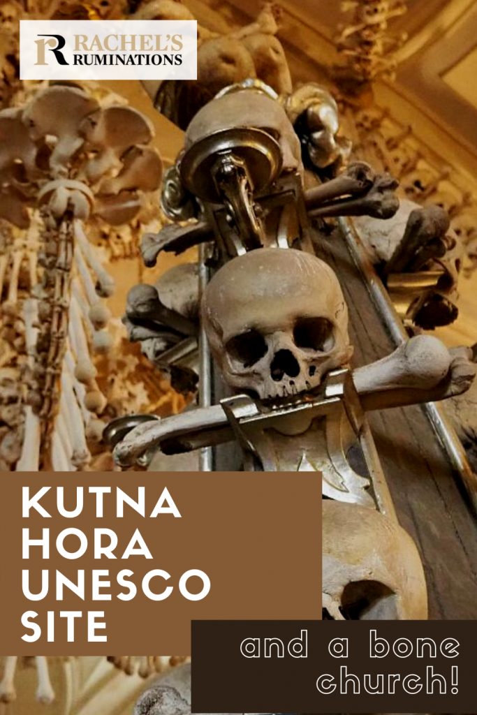 Pinnable image Text: Kutna Hora UNESCO site and a bone church Image: the stand with skulls appearing to have long bones in their mouths.