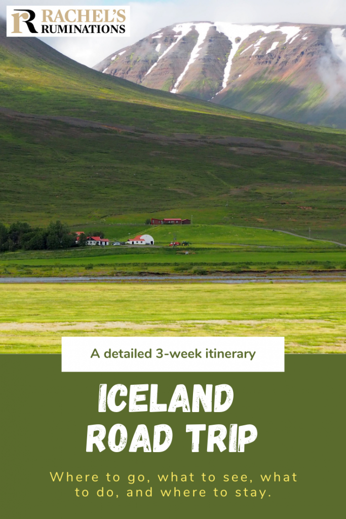 Pinnable image Text: A detailed 3-week Iceland itinerary  Iceland road trip Where to go, what to see, what to do and where to stay. Image: a farm with a 3-4 buildings at the bottom of the photo, a green hill rising behind it, and behind that, a much steeper rockier mountain, with snow on it still.