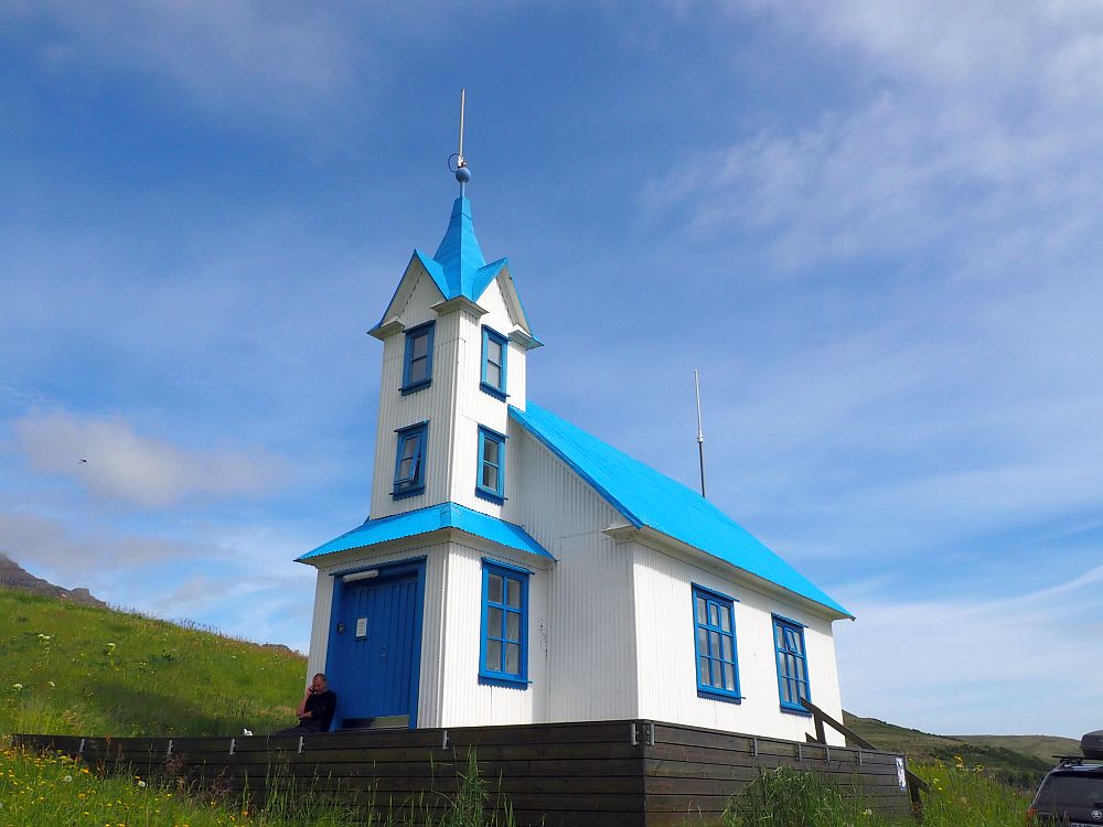 A particularly pretty church: A simple design, but the walls are white, while the roof, the door and the window frames are bright blue. the steeple is unusual in that it's a bit taller than on most Icelandic churchs and has two levels of windows in it above the ground level.