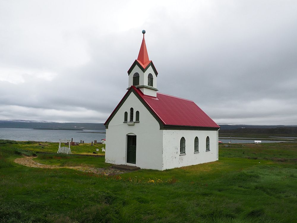 Another picturesque Icelanding church: white with a red roof. This time the steeple isn't attached on the end above the entrance vestibule, like most of them, but added on one end of the roof's peak.